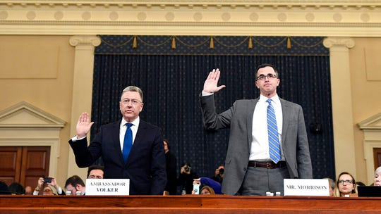 Ambassador Kurt Volker, left, former special envoy to Ukraine, and Tim Morrison, a former official at the National Security Council are sworn in to testify before the House Intelligence Committee on Capitol Hill in Washington, Tuesday, Nov. 19, 2019.