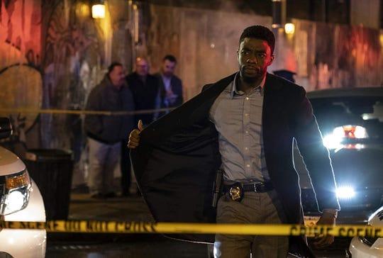 "Chadwick Boseman in ""21 Bridges."""
