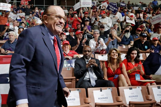 FILE - In this Aug. 15, 2019, file photo, former New York City Mayor Rudy Giuliani smiles as he arrives to President Donald Trump's campaign rally in Manchester, N.H.