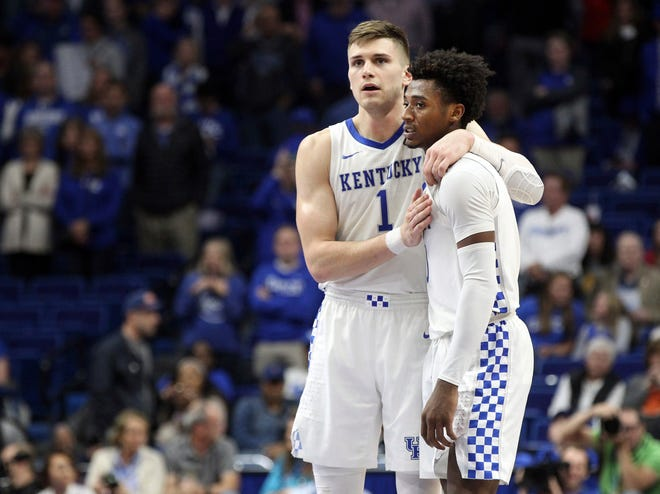Kentucky's Nate Sestina, left, and Ashton Hagans hug in the closing moments of Monday's win against Utah Valley.