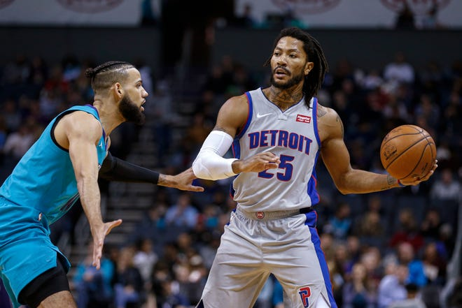 Pistons guard Derrick Rose, right, has had his playing time closely monitored this season.