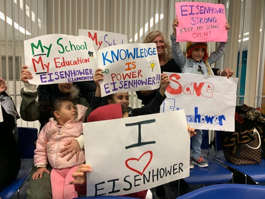 Students from a school proposed for closure appear at Tuesday's meeting for Flint Community Schools, asking the school board to keep it open.
