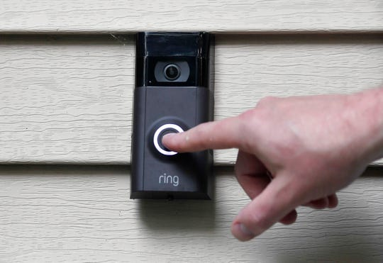 FILE - In this July 16, 2019, file photo, Ernie Field pushes the doorbell on his Ring doorbell camera at his home in Wolcott, Conn.