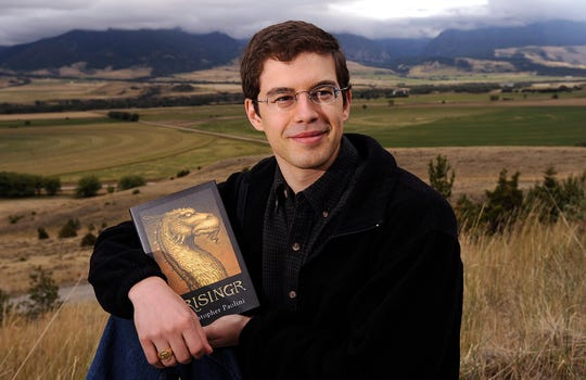 "Christopher Paolini with his book ""Brisingr"" in Paradise Valley, Mont."