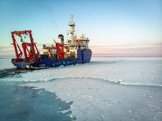 This Nov. 14, 2019, photo taken from an aerial drone shows the research vessel Sikuliaq as it makes its way through thin sea ice in the Beaufort Sea off Alaska's north coast.