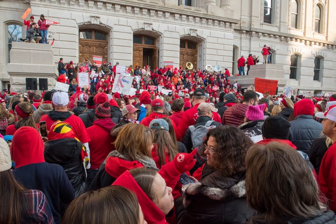 Educators protest on the south side of the Statehouse in  downtown Indianapolis, Ind., while participating in the Red for Ed Action Day rally Tuesday Morning, Nov. 19, 2019.