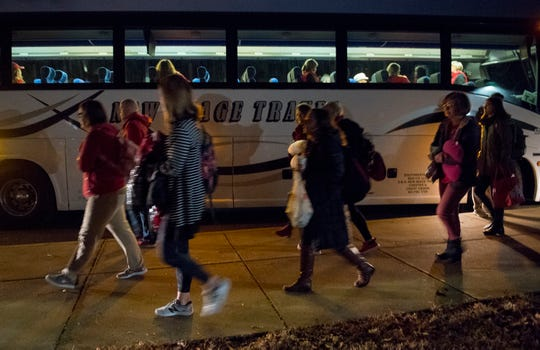 Local teachers board buses headed to the Indiana Statehouse to participate in Red for Ed Action Day Tuesday morning, Nov. 19, 2019.