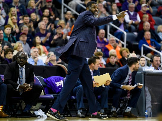 University of Evansville Head Coach Walter McCarty reacts after a charging foul is called on Evansville's K.J. Riley (33) during the second half against the Southern Methodist University Mustangs at Ford Center in Evansville, Ind., Monday, Nov. 18, 2019. The UE Purple Aces fell 59-57 to the SMU Mustangs.
