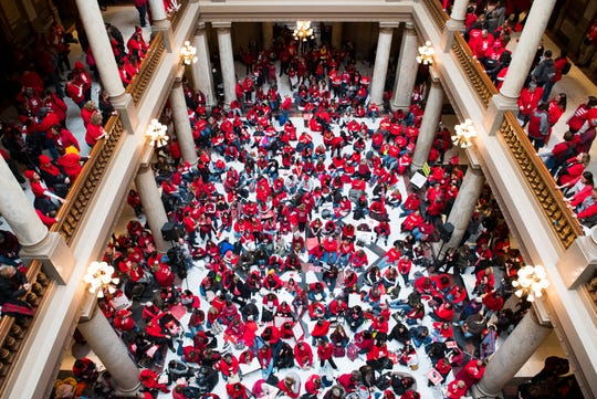 Protesters for education reform fill the South Atrium of the Statehouse during the Red for Ed Action Day rally in Downtown Indianapolis Tuesday afternoon, Nov. 19, 2019.
