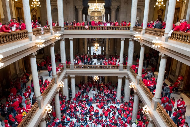Protesters for education reform fill three floors of the Statehouse during the Red for Ed Action Day rally in Downtown Indianapolis Tuesday afternoon, Nov. 19, 2019.