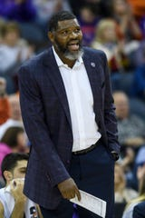 University of Evansville Head Coach Walter McCarty talks to his team during the second half against the Southern Methodist University at Ford Center in Evansville, Ind., Monday, Nov. 18, 2019. The UE Purple Aces fell 59-57 to the SMU Mustangs.