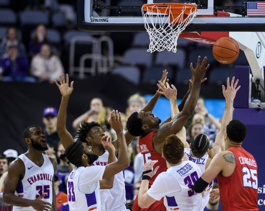 Southern Methodist University's Isiaha Mike (15) and Evansville's Artur Labinowicz (2) collide as they fight for a rebound during the second half at Ford Center in Evansville, Ind., Monday, Nov. 18, 2019. The UE Purple Aces fell 59-57 to the SMU Mustangs.