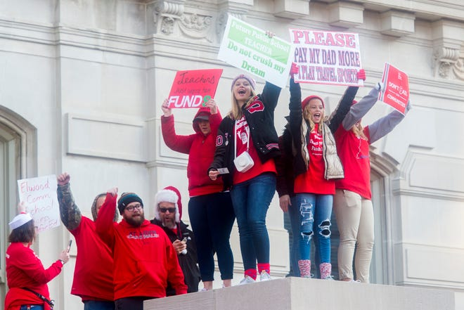 Teachers and students gather in front of the Statehouse in downtown Indianapolis, Ind., while participating in the Red for Ed Action Day rally Tuesday afternoon, Nov. 19, 2019.