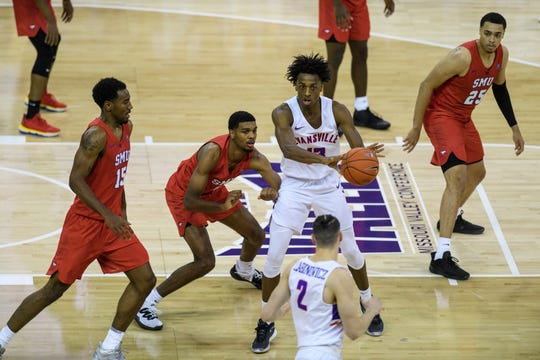 Evansville's DeAndre Williams (13) prepares to make a pass while talking to teammate Artur Labinowicz (2) during the second half against the Southern Methodist University Mustangs at Ford Center in Evansville, Ind., Monday, Nov. 18, 2019. The UE Purple Aces fell 59-57 to the SMU Mustangs.