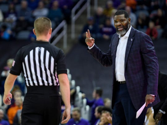 University of Evansville Head Coach Walter McCarty disagrees with a foul called on his team during the first half Against the Southern Methodist University Mustangs at Ford Center in Evansville, Ind., Monday, Nov. 18, 2019.