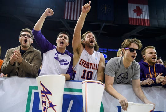 University of Evansville Purple Aces student section fans cheer for their team as they take on the Southern Methodist University Mustangs at Ford Center in Evansville, Ind., Monday evening, Nov. 18, 2019. The UE Purple Aces fell 59-57 to the SMU Mustangs.