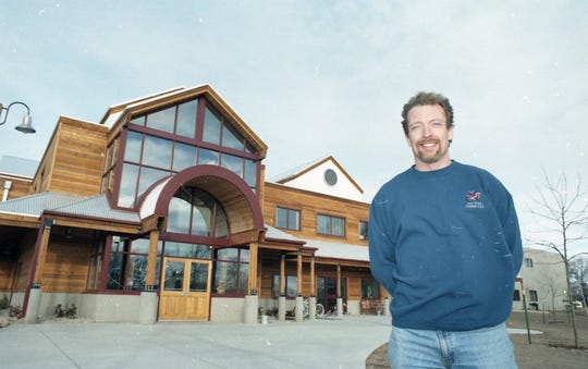 New Belgium Brewing co-founder Jeff Lebesch stands in front of the brewery's 500 Linden St. location before its opening.