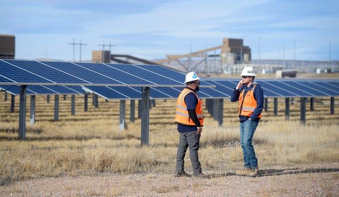 Sam Ocampo, left, a DEPCOM construction manager, and Kenny Stewart, a DEPCOM field engineer, walk through the Rawhide Flats Solar site in Wellington, Colo. on Tuesday, Nov. 19, 2019.