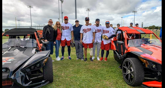 """Twins players Lewis Thorpe, Brusdar Graterol and Luis Arraez, Class AA manager Ramon Borrego and coach Luis Ramirez joined organizers Chris Risola and Eric """"Raz"""" Rasmussen for the Let Kids Be Kids Clinic."""