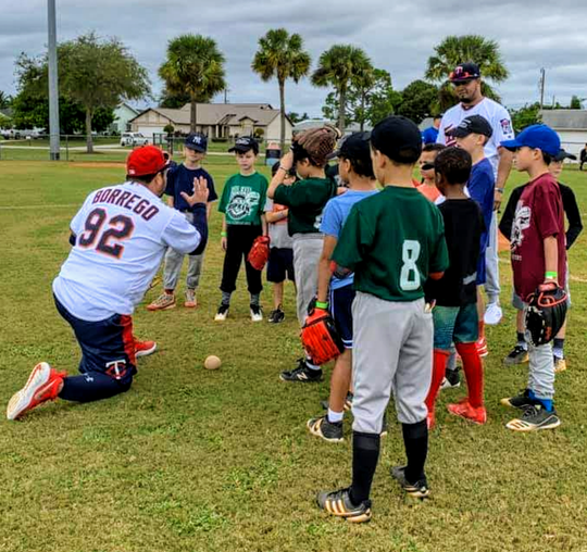 Twins Class AA manager Ramon Borrego instructs kids during the Let Kids Be Kids Clinic at Pelican Baseball Complex.