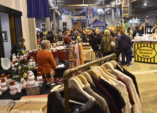Shoppers and vendors fill Lakehaven Hall in Kewaunee during a past Christkindlmarkt, the city's annual old-fashioned, German Christmas gift market. It takes place this year Nov. 22 and 23.