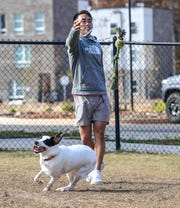 "Dustin Nguyen, plays with his dog Cooper in the dog park at EPOCH Clemson apartments, an 818 bed student living complex which opened mid-August, just outside Clemson in Seneca. ""Our apartment wasn't even done when it was supposed to be finished. That was pretty annoying. They paid for our hotel, I guess they had to. I graduate in December so I can't even use the pool,"" Nguyen said."