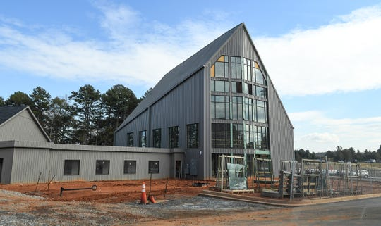 The pool house and pool are under construction at EPOCH Clemson apartments just outside Clemson in Seneca. The student living site with 818 beds opening was in mid-August, with some students needing to stay in nearby paid-for hotels until their room was ready to move in.