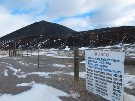 """This Dec. 15, 2016 photo shows a slag pile of mining waste in Anaconda, Mont. Environmental regulators have put a halt to a Montana business association's sale of sandwich bags of mining waste advertised as a """"Bag O' Slag."""" Environmental Protection Agency officials overseeing the Superfund cleanup of pollution from decades of smelter operations in Anaconda came across the potentially toxic tchotchkes for sale by the city's chamber of commerce. The slag contains small amounts of arsenic and lead. Mary Johnston, the chamber's executive director, said Monday, Nov. 18, 2019 the EPA asked them to stop selling the black slag in a re-sealable bag and gave them some alternatives. (AP Photo/Matt Volz)"""