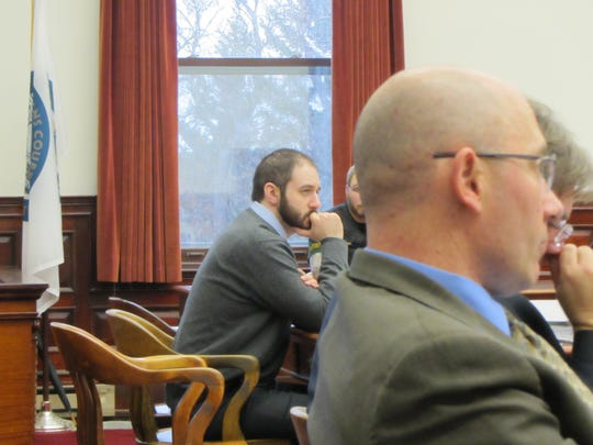 Brandon Lee Craft, left, waits as his attorney gives closing statements during his trial for the 2016 killing of Adam Petzack. Cascade County Attorney Josh Racki can be seen in the foreground.