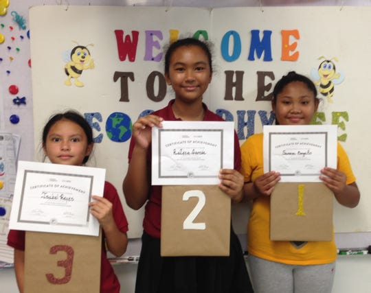 Geography bee top three finishers, from left 3rd place Isabel Reyes, 4th grade, 2nd place Kaleia Garcia, 5th grade and 1st place Samara Bongato, 5th grade.