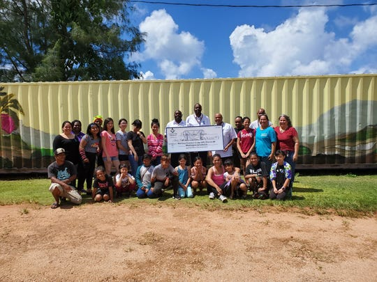 Members of the Prince Hall Masonic Family, District Eight, donated $1,000 to support Island Girl Power in their community outreach program on Oct. 26.