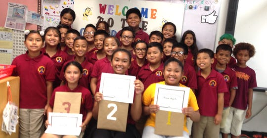 Capt. H.B. Price Elementary School held its annual geography bee. There were 26 students in grades 3-5, who answered 50 questions.  Front row sitting from left: 3rd place Isabel Reyes, 4th grade; 2nd place Kaleia Garcia, 5th grade; and 1st place Samara Bongato, 5th grade. Second row from left: Anya Fernandez, Zeikyn Pangelinan, Cyan Sablan, Sinahi King, Xavier Yano, and Dante Calvo. Third row from left: Vayla Gumabon, Gabriel Macaraeg, Kaiden Peter, Kekoa Garcia, Cameron Sablan, and Liam Lagauna. Fourth row from left: Skyler Francisco, Kepuha Noket, Preston Pangelinan, Drady Cruz, Mike Clement III, and Slade De Gracia. Back row from left: Kaitlin Kaipat, MollySky Dahilig (partially hidden), Felix Ulloa, Abigial Lopez, and Nova Pagan.