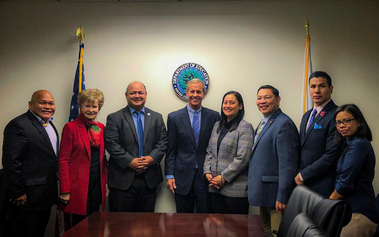 Vice Speaker Telena Nelson poses with Frank Brogan, Assistant Secretary for Elementary and Secondary Education, fourth from left, Washington D.C. liaison and former Congresswoman Madeleine Bordallo, Guam Education Board Chairman Mark Mendiola, Guam Department of Education Superintendent Jon Fernandez and other GDOE representatives after a November meeting to discuss the lifting of GDOE's high-risk designation in Washington D.C.