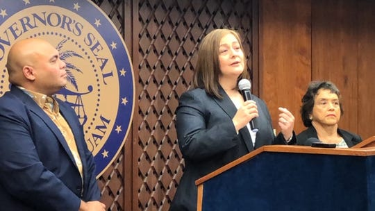 Judge-Designee Dana Gutierrez gestures as she addresses the crowd at Adelup on Nov. 19, 2019, while Gov. Lou Leon Guerrero, right, and Lt. Gov. Josh Tenorio, left, look on at a ceremony wherein the governor announced her appointment of Gutierrez to serve as an 8th judge in the Superior Court of Guam.