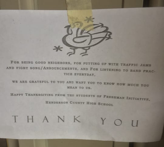 Students, supervised by teachers, left these notes on the doors of the houses where they raked leaves Tuesday.