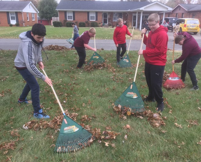 As part of the Freshmen Initiative, ninth-grade students at Henderson County High School fanned out across the neighborhood next to the school Tuesday morning, raking leaves to the street so they could be picked up by city of Henderson workers. From left are Ethan Johnson, Blake Jones (in maroon), Levi Jones, Sam Wells and Mason Workins.