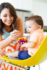 Ahimsa's infant products come with a patent-pending spoon that hooks onto the bowl.