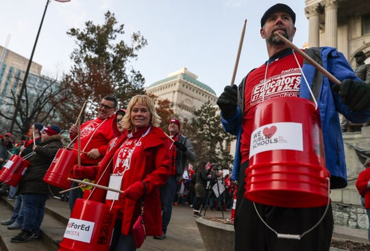 Red For Ed demonstrators beat on makeshift drums to rally teachers and supporters Tuesday, Nov. 19, 2019.