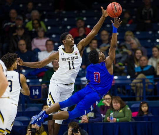 Notre Dame's Juwan Durham (11) blocks Presbyterian's Chris Martin (0) from shooting during an NCAA college basketball game Monday, Nov. 18, 2019,  in South Bend, Ind.