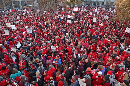 Thousands of teachers line blanket the lawn of the Indiana Statehouse Tuesday, Nov. 19, 2019 for the Red For Ed rally.