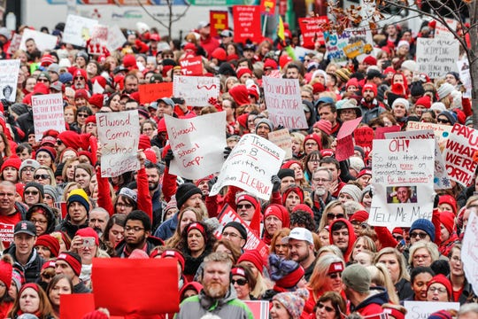 Teachers and their supporters protest during the Red for Ed Action Day at the Indiana Statehouse on Tuesday, Nov. 19, 2019.
