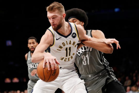 Brooklyn Nets center Jarrett Allen, right, defends against Indiana Pacers forward Domantas Sabonis (11) during the first half of an NBA basketball game, Monday, Nov. 18, 2019, in New York.