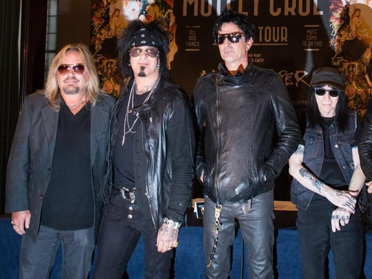 Motley Crue (from left, Vince Neil, Nikki Sixx, Tommy Lee and Mick Mars) attend a 2015 press conference in London.