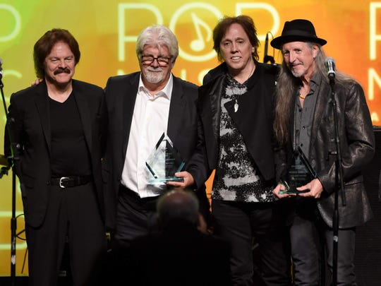 Musicians Tom Johnston, from left, Michael McDonald, John McFee and Patrick Simmons will unite for a Doobie Brothers tour in 2020.