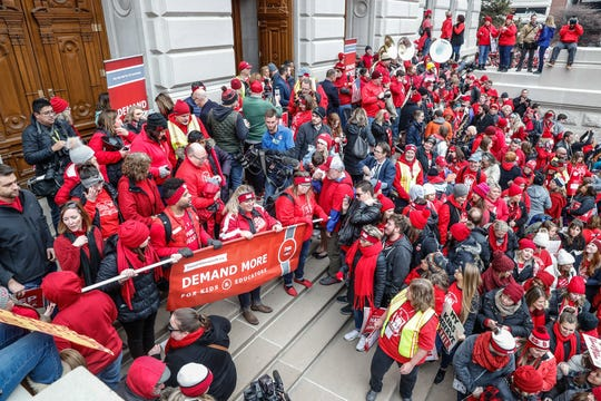 Teachers and their supporters begin a march from the Indiana Statehouse, through downtown Indianapolis, during the Red for Ed Action Day at on Tuesday, Nov. 19, 2019.