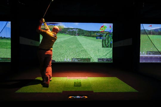 Owner Jared Parras shows IndyStar X-Golf Carmel during the soft opening, Tuesday, Nov. 19, 2019, at Clay Terrace Outdoor shopping mall, Carmel, Ind. X-Golf Carmel is simulated golfing entertainment in Indiana and will be opening Saturday, Nov. 23, 2019.