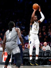 Nov 18, 2019; Brooklyn, NY, USA; Indiana Pacers guard Aaron Holiday (3) takes a shot against Brooklyn Nets forward Taurean Prince (2) during the first half at Barclays Center.