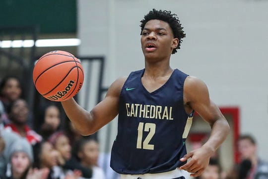 Cathedral guard Tayshawn Comer  scored 11 of his game-high 27 points in the fourth quarter.