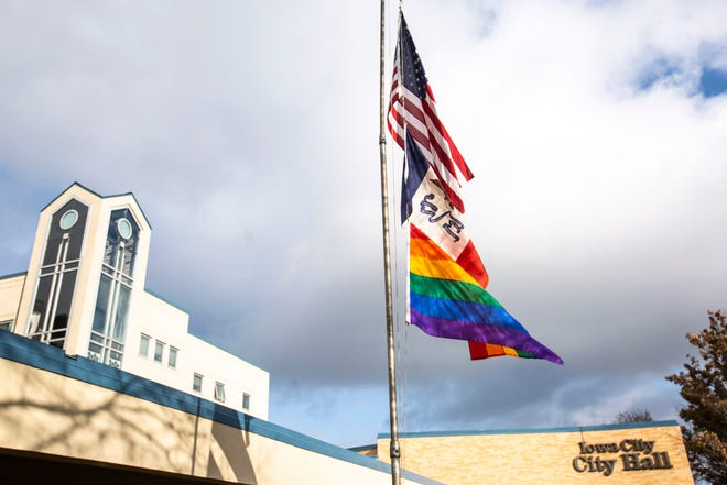 United States, Iowa, and the LGBTQ Pride Flag wave on a flag pole, Tuesday, Nov., 19, 2019, at City Hall in Iowa City, Iowa.