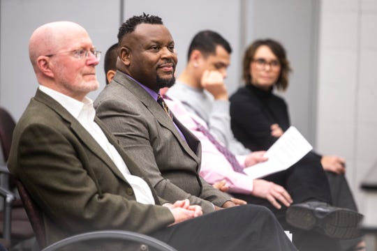 Iowa City Councilor Bruce Teague, second from left, listens to a speaker alongside Jim Throgmorton, mayor of Iowa City, during a municipal equality index scorecard launch event with the Human Rights Campaign Foundation (HRC), Tuesday, Nov., 19, 2019, at City Hall in Iowa City, Iowa. Teague is the first openly gay man of color to serve on council.